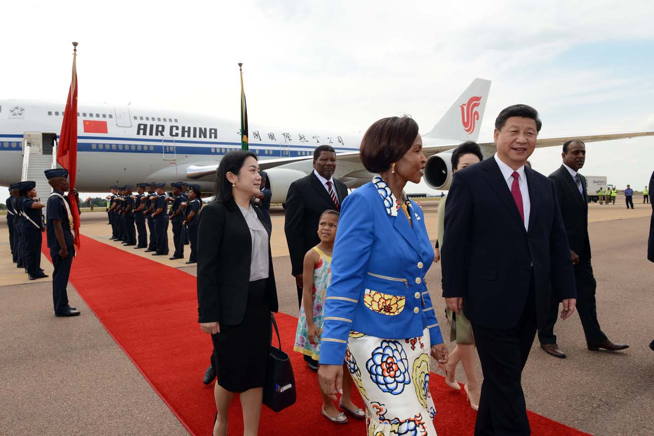 Arrive.jpg - President of the PeopleÕs Republic of China, His Excellency Mr Xi Jinping arrives at Waterkloof AFB ahead of the State Visit. Later President Jinping will attend FOCAC. The boy who handed President Jinping flowers is Dzunani Manzini from Thatchfield Curro School Pretoria. Picture byline: Jacoline Schoonees. President Zuma to receive the President of the PeopleÕs Republic of China on a State Visit to South Africa His Excellency President Jacob Zuma will on Wednesday, 02 December 2015, host the President of the PeopleÕs Republic of China, His Excellency Mr Xi Jinping, on a State Visit to South Africa. During the State Visit of President Jacob Zuma to China in December 2014, the two countries concluded the ÒFive-to-Ten Year Strategic Programme for Cooperation between the Republic of South Africa and the PeopleÕs Republic of ChinaÓ. The two leaders will engage in bilateral talks where they will look at the progress made thus far on the Strategic Programme with specific reference to the six priority areas identified for 2015, namely: ´Alignment of industries to accelerate South AfricaÕs industrialization process; ´ Enhancement of cooperation in Special Economic Zones (SEZs); ´ Enhancement of marine cooperation; ´ Infrastructure development ´ Human resources cooperation; and ´ Financial cooperation. South AfricaÕs relations with China are at the level of a Comprehensive Strategic Partnership (CSP). The Beijing Declaration on the Establishment of a Comprehensive Strategic Partnership encapsulates all facets of South AfricaÕs relations with China, where China has committed to the respective developmental objectives. The focus of the State Visit will, therefore, be on economic and trade relations between the two countries. Total trade between South Africa and China experienced an upward trajectory since 2009, growing from R118 billion to R271 billion by the end of 2013. While there is a trade imbalance between China and South Africa, both countries have im